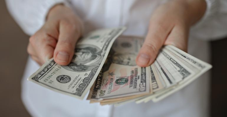 a-woman-holding-money-ZT4896N.jpg